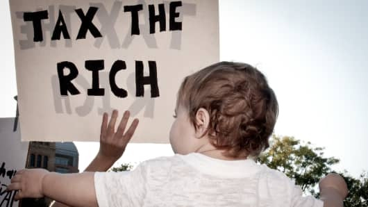 Protesters call for tax increases on the wealthy.
